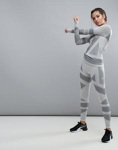 Серые леггинсы Puma Evoknit - Серый