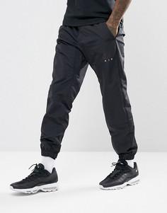 Черные тканые брюки Nike Air 861630-010 - Черный