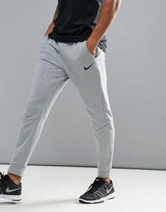 Суженные книзу серые брюки Nike Training Dri-FIT 860371-063 - Серый