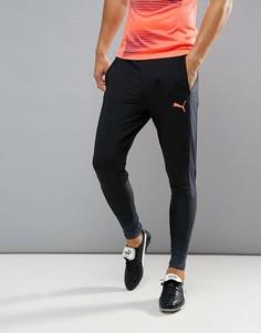 Черные спортивные брюки Puma Football evoTRG Tech 65536106 - Черный