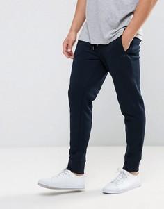 Темно-синие трикотажные джоггеры с логотипом и манжетами Armani Jeans - Темно-синий