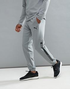 Серые флисовые брюки для бега Puma Future Tech 59247803 - Серый