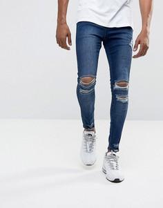 Синие джинсы скинни с рваной отделкой Illusive London - Синий
