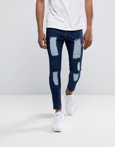 Темно-синие супероблегающие джинсы с состаренной отделкой Illusive London - Синий