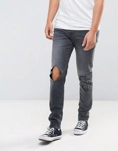 Черные винтажные джинсы скинни с рваной отделкой ASOS - Черный