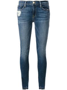 джинсы скинни с рваными деталями Frame Denim