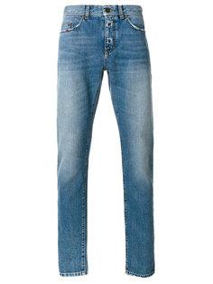 джинсы с заниженной посадкой и эффектом потертости Saint Laurent