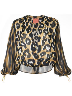 Born Free wrap top Manning Cartell
