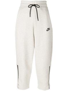 high waisted cropped track pants Nike