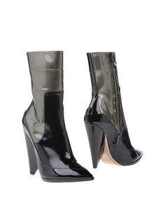 Полусапоги и высокие ботинки Nina Ricci
