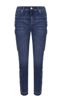 Укороченные джинсы с потертостями Alexander McQueen