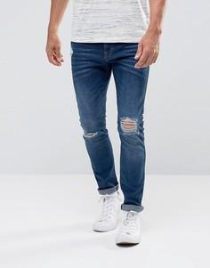 Эластичные зауженные джинсы c рваной отделкой Esprit - Синий
