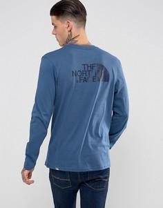 Синий лонгслив с логотипом на спине The North Face - Синий
