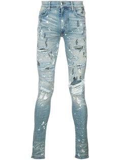 джинсы с рваными деталями Amiri