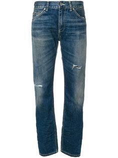 джинсы с прорехами  Dondup