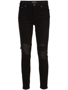 distressed skinny jeans with under layer Amiri