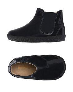 Полусапоги и высокие ботинки Falcotto