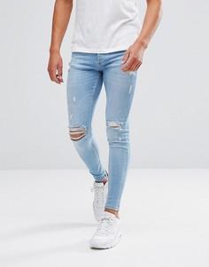 Голубые супероблегающие джинсы с рваной отделкой Kings Will Dream - Синий
