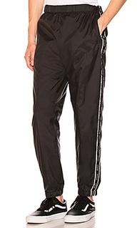 Спортивные брюки warm up - Stussy