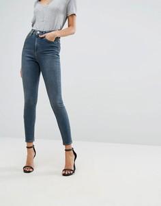 Темно-синие выбеленные джинсы скинни с завышенной талией ASOS RIDLEY - Синий