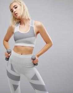 Серый спортивный бюстгальтер Puma Evoknit - Серый