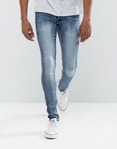 Умеренно выбеленные синие джинсы скинни из эластичного денима Solid - Синий