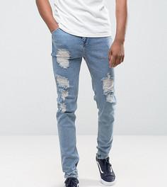 Голубые суженные книзу джинсы с рваной отделкой ASOS TALL - Синий
