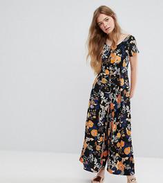 Комбинезон с широкими штанинами и ярким цветочным принтом Monki - Черный