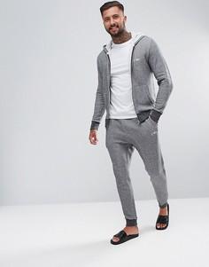 Серые спортивные штаны узкого кроя с манжетами и логотипом Emporio Armani - Серый