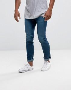 Темные узкие эластичные джинсы Diesel Thommer 686A - Синий