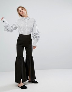 Расклешенные брюки с разрезами Style Mafia - Черный