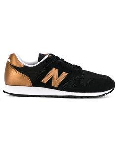 кроссовки с панелями металлик New Balance