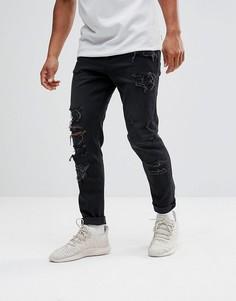Суженные книзу черные выбеленные джинсы с рваной отделкой из денима плотностью 12,5 унции ASOS - Черный