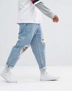 Голубые выбеленные свободные джинсы с рваной отделкой ASOS - Синий