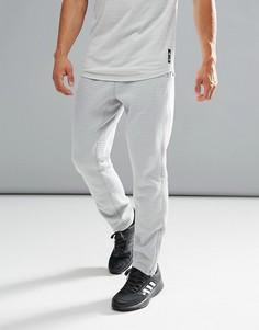 Флисовые спортивные штаны серого цвета adidas X Reigning Champ BR8388 - Серый