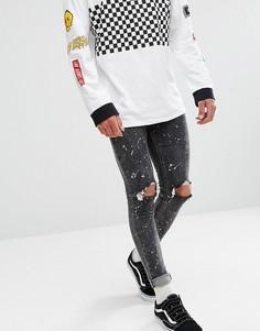 Черные выбеленные джинсы скинни с рваной отделкой и принтом New Look - Черный