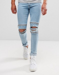 Светлые супероблегающие джинсы с молниями ASOS - Синий
