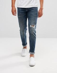 Узкие темно-синие джинсы с рваным коленом ASOS - Синий
