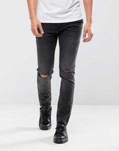 Черные облегающие джинсы с рваными коленями Cheap Monday - Черный