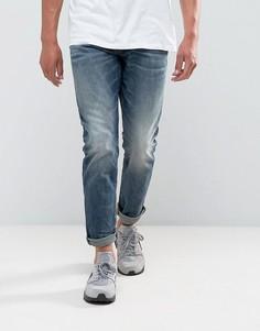 Суженные книзу темные джинсы G-Star 3302 - Синий