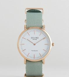 Часы 36 мм с парусиновым ремешком оливкового цвета Reclaimed Vintage Inspired эксклюзивно для ASOS - Зеленый