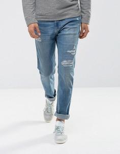 Зауженные джинсы с рваной отделкой Hollister - Синий