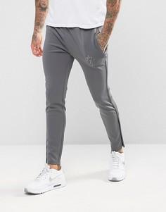Серые спортивные джоггеры скинни со светоотражающим логотипом Gym King - Серый