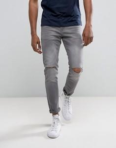 Темно-серые джинсы скинни с рваной отделкой River Island - Серый