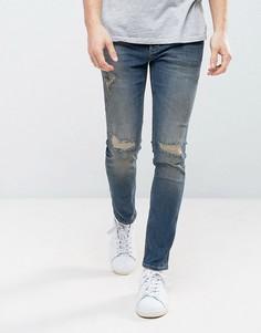 Темные выбеленные джинсы скинни с прорехами River Island - Синий