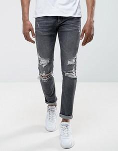 Черные джинсы скинни с рваной отделкой River Island - Черный