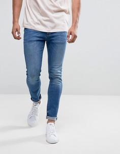 Умеренно выбеленные синие джинсы скинни River Island - Синий