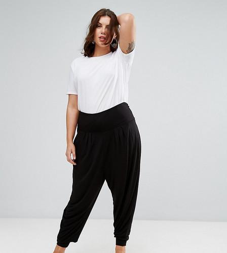 Трикотажные гаремные брюки с отворотом на талии ASOS CURVE - Черный