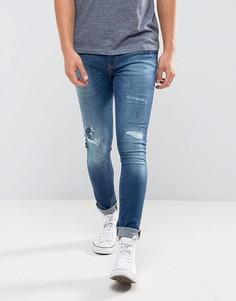 Выбеленные джинсы скинни с потертой отделкой River Island - Синий