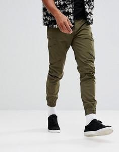 Зеленые суженные брюки карго Timberland - Зеленый